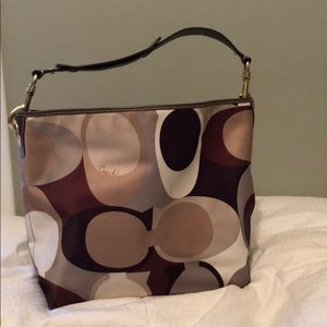 Coach shoulder hobo bag in browns and green.